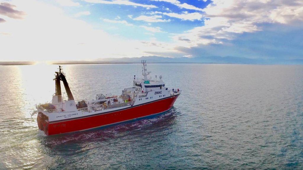 Fishing vessel Amaltal Columbia heads out in the early morning.